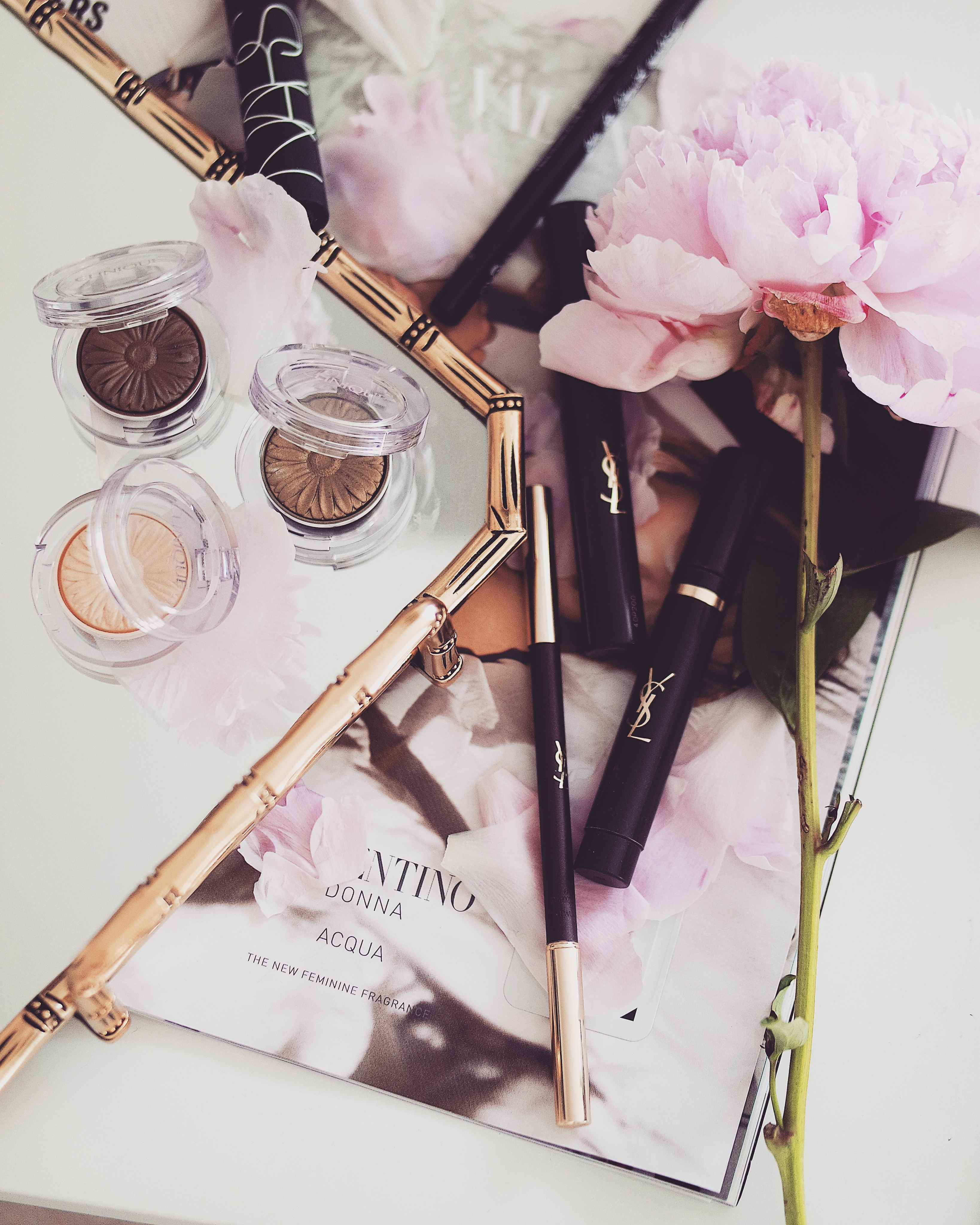 Travel Beauty Essentials - Flatlay of Eye Make Up Products