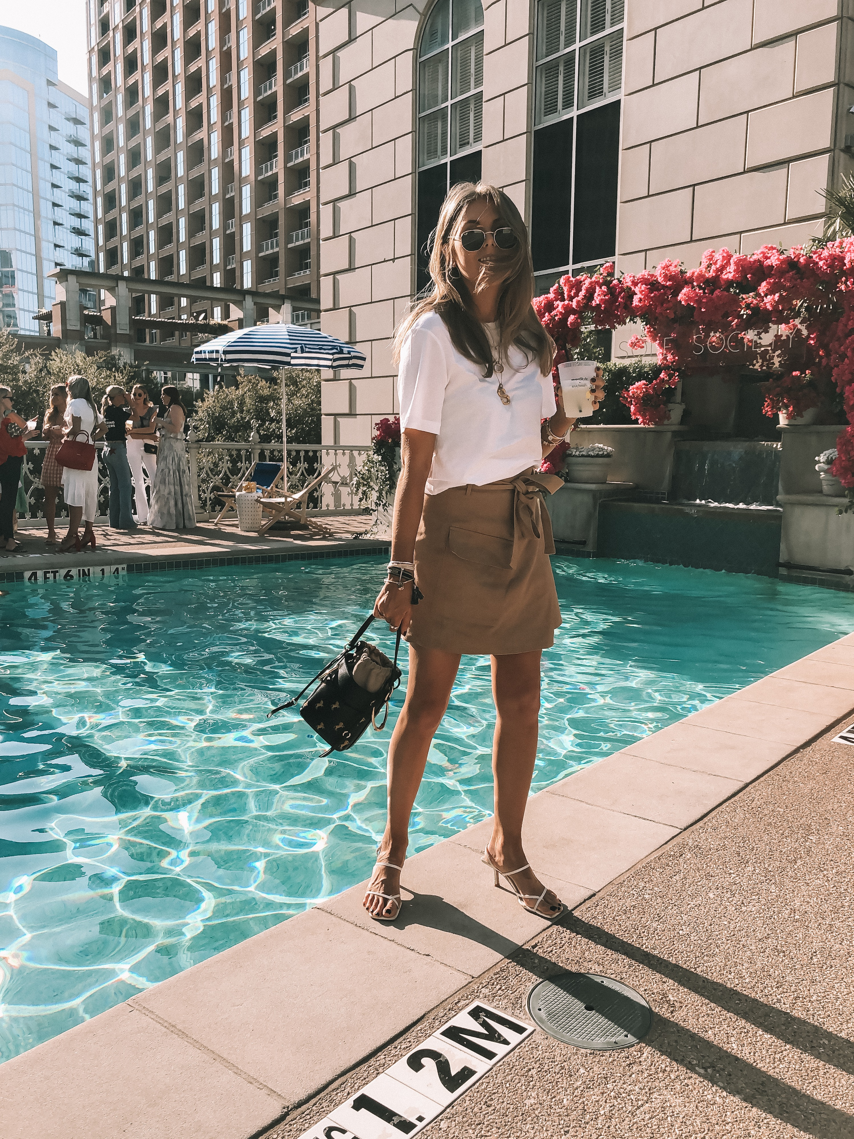 Spring outfit by pool at rewardstyle conference, hotel crescent, dallas texas