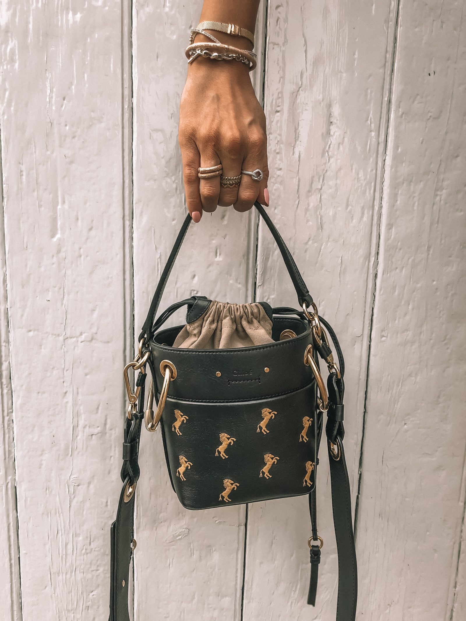 Navy Chloe Roy Mini Bucket Bag with yellow embroidered horses & lots of pandora stacking rings!