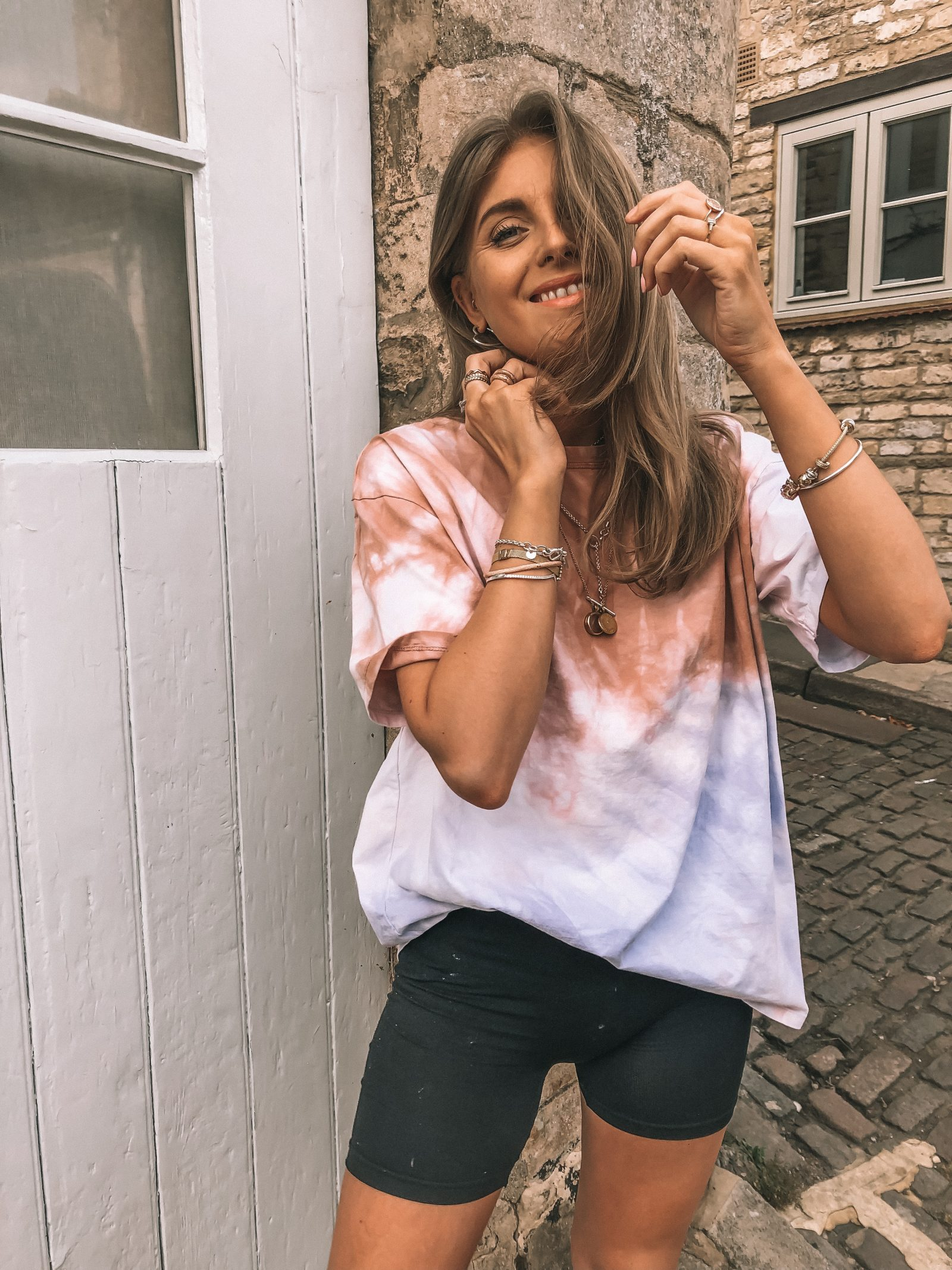 Zara tye dye t shirt styled with cycling shorts for spring - SS19 trends